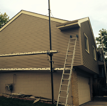 Best Siding, Coil Wraps, Windows, Doors project photo in Omaha lesage7.jpg
